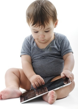 Toddler playing with tablet